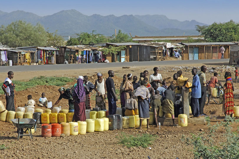 People standing in a queue to collect<p> clean drinking water, Kenya