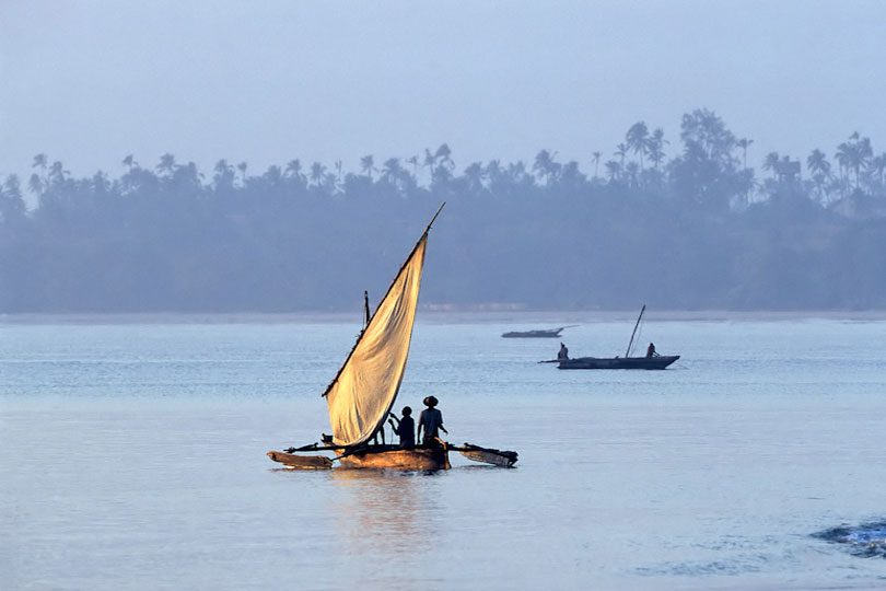 Fishermen sailing out to fish at sunrise, Bagamoyo, Tanzania